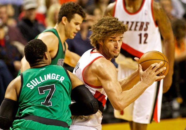 Jan 11, 2014; Portland, OR, USA; Portland Trail Blazers center Robin Lopez (42) drives to the basket past Boston Celtics power forward Jared Sullinger (7) at the Moda Center. Mandatory Credit: Craig Mitchelldyer-USA TODAY Sports