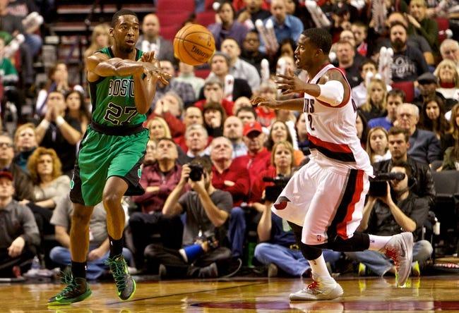 Jan 11, 2014; Portland, OR, USA; Boston Celtics shooting guard Jordan Crawford (27) passes away from Portland Trail Blazers shooting guard Wesley Matthews (2) at the Moda Center. Mandatory Credit: Craig Mitchelldyer-USA TODAY Sports