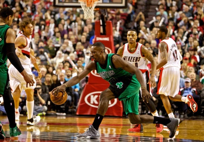 Jan 11, 2014; Portland, OR, USA; Boston Celtics small forward Jeff Green (8) reaches for a loose ball against the Portland Trail Blazers at the Moda Center. Mandatory Credit: Craig Mitchelldyer-USA TODAY Sports