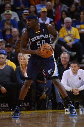 November 20, 2013; Oakland, CA, USA; Memphis Grizzlies power forward Zach Randolph (50) controls the basketball during the third quarter against the Golden State Warriors at Oracle Arena. The Grizzlies defeated the Warriors 88-81 in overtime. Mandatory Credit: Kyle Terada-USA TODAY Sports