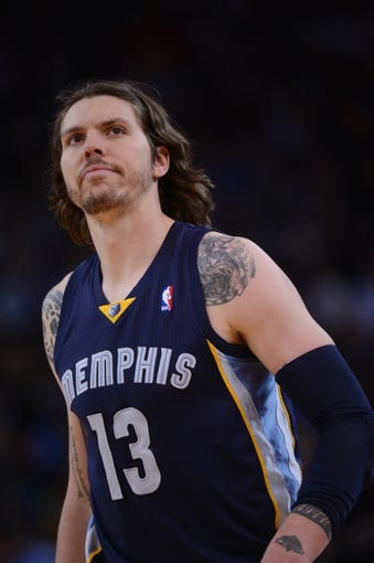November 20, 2013; Oakland, CA, USA; Memphis Grizzlies small forward Mike Miller (13) looks on during the third quarter against the Golden State Warriors at Oracle Arena. The Grizzlies defeated the Warriors 88-81 in overtime. Mandatory Credit: Kyle Terada-USA TODAY Sports