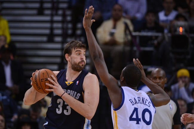 November 20, 2013; Oakland, CA, USA; Memphis Grizzlies center Marc Gasol (33) controls the basketball against Golden State Warriors small forward Harrison Barnes (40) during overtime at Oracle Arena. The Grizzlies defeated the Warriors 88-81 in overtime. Mandatory Credit: Kyle Terada-USA TODAY Sports