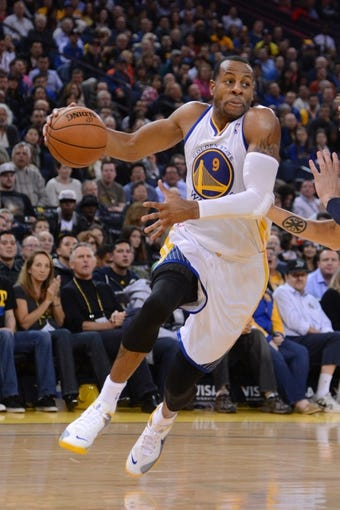 November 20, 2013; Oakland, CA, USA; Golden State Warriors small forward Andre Iguodala (9) dribbles the basketball during the third quarter against the Memphis Grizzlies at Oracle Arena. The Grizzlies defeated the Warriors 88-81 in overtime. Mandatory Credit: Kyle Terada-USA TODAY Sports
