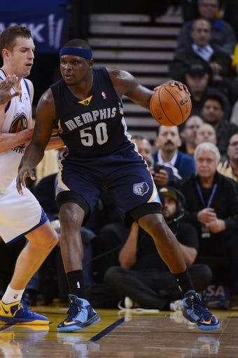 November 20, 2013; Oakland, CA, USA; Memphis Grizzlies power forward Zach Randolph (50) dribbles he basketball during the third quarter against the Golden State Warriors at Oracle Arena. The Grizzlies defeated the Warriors 88-81 in overtime. Mandatory Credit: Kyle Terada-USA TODAY Sports