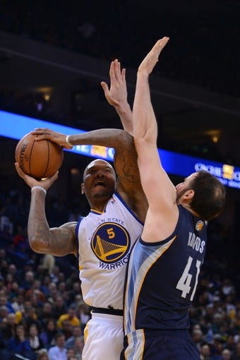 November 20, 2013; Oakland, CA, USA; Golden State Warriors power forward Marreese Speights (5) shoots the basketball against Memphis Grizzlies center Kosta Koufos (41) during the fourth quarter at Oracle Arena. The Grizzlies defeated the Warriors 88-81 in overtime. Mandatory Credit: Kyle Terada-USA TODAY Sports