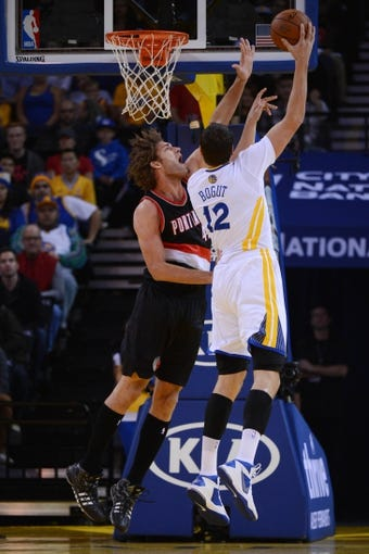 November 23, 2013; Oakland, CA, USA; Portland Trail Blazers center Robin Lopez (42, left) defends the shot of Golden State Warriors center Andrew Bogut (12) during the first quarter at Oracle Arena. The Trail Blazers defeated the Warriors 113-101. Mandatory Credit: Kyle Terada-USA TODAY Sports