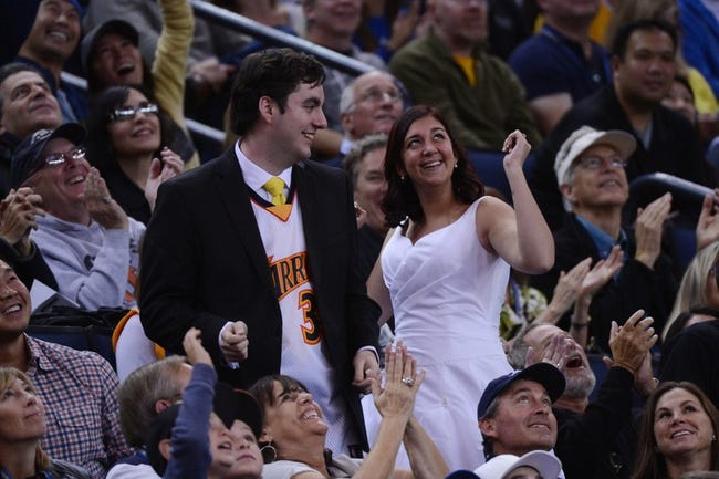 November 23, 2013; Oakland, CA, USA; A newlywed couple dances during the second quarter between the Golden State Warriors and the Portland Trail Blazers at Oracle Arena. The Trail Blazers defeated the Warriors 113-101. Mandatory Credit: Kyle Terada-USA TODAY Sports