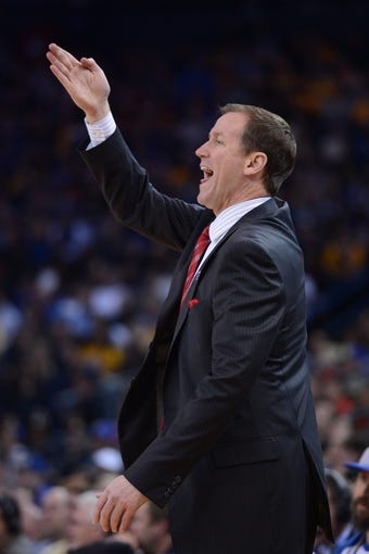 November 23, 2013; Oakland, CA, USA; Portland Trail Blazers head coach Terry Stotts instructs during the second quarter against the Golden State Warriors at Oracle Arena. The Trail Blazers defeated the Warriors 113-101. Mandatory Credit: Kyle Terada-USA TODAY Sports
