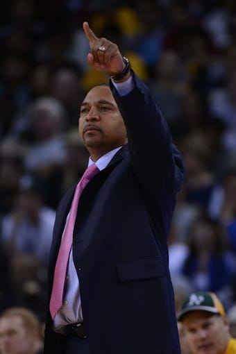 November 23, 2013; Oakland, CA, USA; Golden State Warriors head coach Mark Jackson instructs during the third quarter against the Portland Trail Blazers at Oracle Arena. The Trail Blazers defeated the Warriors 113-101. Mandatory Credit: Kyle Terada-USA TODAY Sports