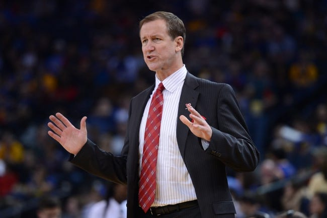 November 23, 2013; Oakland, CA, USA; Portland Trail Blazers head coach Terry Stotts reacts during the third quarter against the Golden State Warriors at Oracle Arena. The Trail Blazers defeated the Warriors 113-101. Mandatory Credit: Kyle Terada-USA TODAY Sports