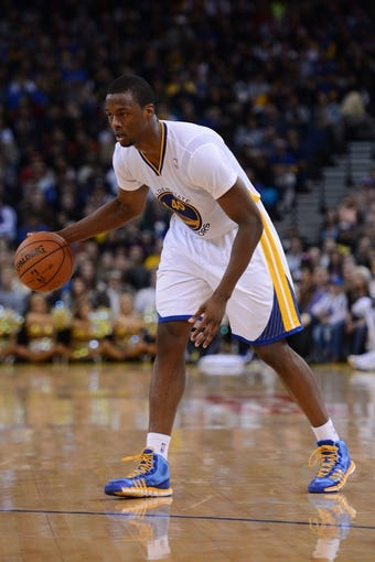 November 23, 2013; Oakland, CA, USA; Golden State Warriors small forward Harrison Barnes (40) dribbles the basketball during the fourth quarter against the Portland Trail Blazers at Oracle Arena. The Trail Blazers defeated the Warriors 113-101. Mandatory Credit: Kyle Terada-USA TODAY Sports