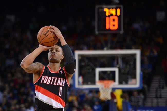 November 23, 2013; Oakland, CA, USA; Portland Trail Blazers point guard Damian Lillard (0) shoots the basketball during the first quarter against the Golden State Warriors at Oracle Arena. The Trail Blazers defeated the Warriors 113-101. Mandatory Credit: Kyle Terada-USA TODAY Sports