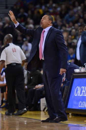 November 23, 2013; Oakland, CA, USA; Golden State Warriors head coach Mark Jackson instructs during the first quarter against the Portland Trail Blazers at Oracle Arena. The Trail Blazers defeated the Warriors 113-101. Mandatory Credit: Kyle Terada-USA TODAY Sports
