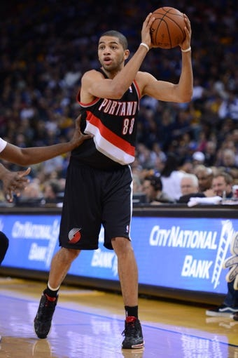 November 23, 2013; Oakland, CA, USA; Portland Trail Blazers small forward Nicolas Batum (88) controls the basketball during the second quarter against the Golden State Warriors at Oracle Arena. The Trail Blazers defeated the Warriors 113-101. Mandatory Credit: Kyle Terada-USA TODAY Sports