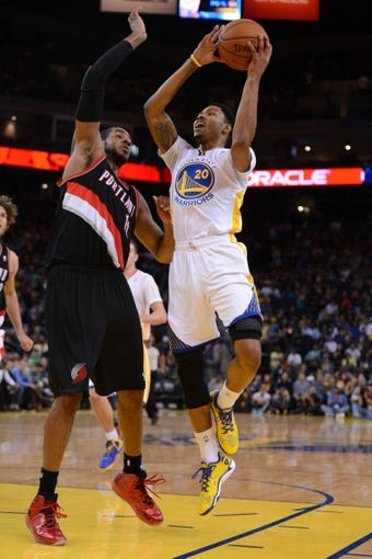 November 23, 2013; Oakland, CA, USA; Golden State Warriors shooting guard Kent Bazemore (20) shoots the basketball against Portland Trail Blazers power forward LaMarcus Aldridge (12, left) during the fourth quarter at Oracle Arena. The Trail Blazers defeated the Warriors 113-101. Mandatory Credit: Kyle Terada-USA TODAY Sports