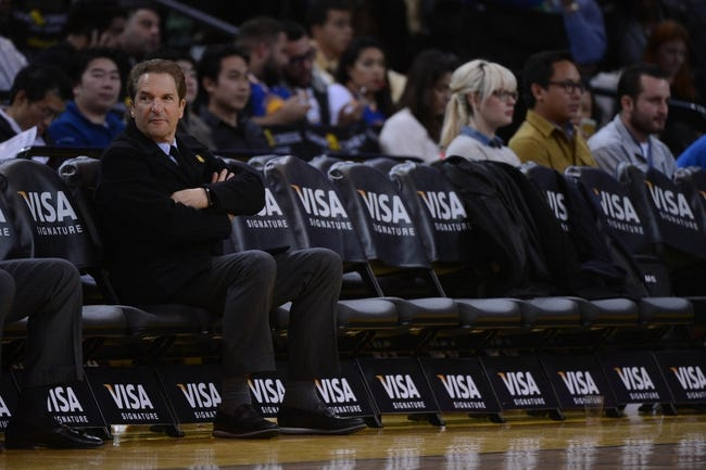 December 3, 2013; Oakland, CA, USA; Golden State Warriors co-owner Peter Guber sits courtside during the third quarter against the Toronto Raptors at Oracle Arena. The Warriors defeated the Raptors 112-103. Mandatory Credit: Kyle Terada-USA TODAY Sports