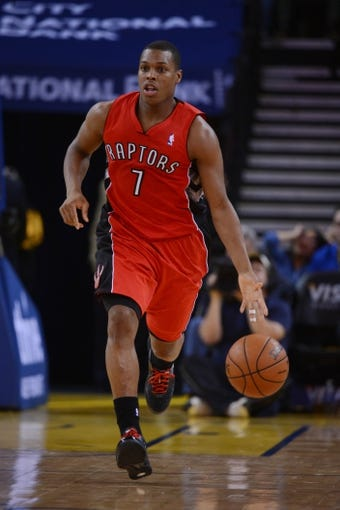 December 3, 2013; Oakland, CA, USA; Toronto Raptors point guard Kyle Lowry (7) dribbles the basketball during the second quarter against the Golden State Warriors at Oracle Arena. The Warriors defeated the Raptors 112-103. Mandatory Credit: Kyle Terada-USA TODAY Sports