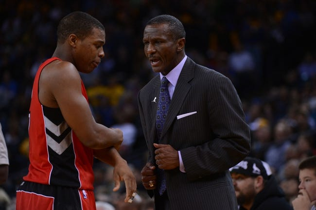 December 3, 2013; Oakland, CA, USA; Toronto Raptors head coach Dwane Casey (right) instructs point guard Kyle Lowry (7) during the second quarter against the Golden State Warriors at Oracle Arena. The Warriors defeated the Raptors 112-103. Mandatory Credit: Kyle Terada-USA TODAY Sports