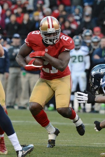 December 8, 2013; San Francisco, CA, USA; San Francisco 49ers running back Frank Gore (21) runs with the football during the fourth quarter against the Seattle Seahawks at Candlestick Park. The 49ers defeated the Seahawks 19-17. Mandatory Credit: Kyle Terada-USA TODAY Sports