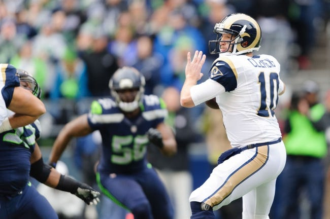 Dec 29, 2013; Seattle, WA, USA; St. Louis Rams quarterback Kellen Clemens (10) during the game against the Seattle Seahawks at CenturyLink Field. Seattle defeated St. Louis 27-9. Mandatory Credit: Steven Bisig-USA TODAY Sports