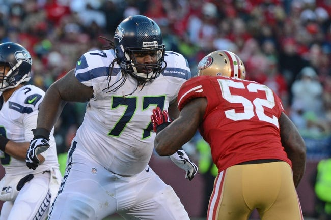 December 8, 2013; San Francisco, CA, USA; Seattle Seahawks guard James Carpenter (77) blocks San Francisco 49ers inside linebacker Patrick Willis (52) during the fourth quarter at Candlestick Park. The 49ers defeated the Seahawks 19-17. Mandatory Credit: Kyle Terada-USA TODAY Sports