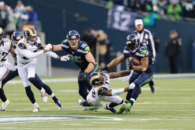 Dec 29, 2013; Seattle, WA, USA; Seattle Seahawks running back Marshawn Lynch (24) stiff arms St. Louis Rams cornerback Trumaine Johnson (22) during the game at CenturyLink Field. Seattle defeated St. Louis 27-9. Mandatory Credit: Steven Bisig-USA TODAY Sports
