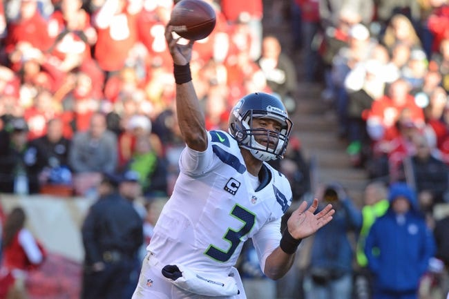 December 8, 2013; San Francisco, CA, USA; Seattle Seahawks quarterback Russell Wilson (3) passes the football during the third quarter against the San Francisco 49ers at Candlestick Park. The 49ers defeated the Seahawks 19-17. Mandatory Credit: Kyle Terada-USA TODAY Sports