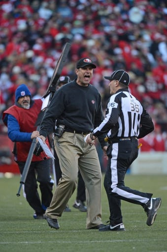 December 8, 2013; San Francisco, CA, USA; San Francisco 49ers head coach Jim Harbaugh (left) argues with NFL head linesman Tony Veteri (36) during the fourth quarter against the Seattle Seahawks at Candlestick Park. The 49ers defeated the Seahawks 19-17. Mandatory Credit: Kyle Terada-USA TODAY Sports
