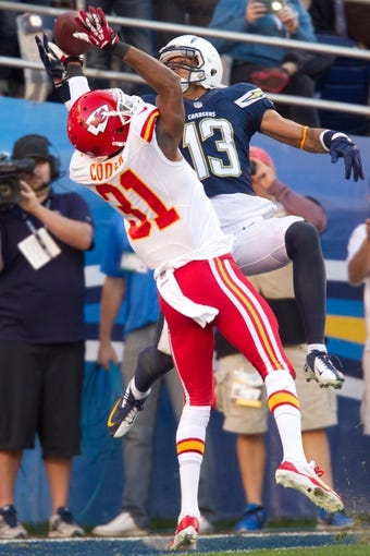 Dec 29, 2013; San Diego, CA, USA;  Kansas City Chiefs cornerback Marcus Cooper (31) breaks up a pass to San Diego Chargers wide receiver Keenan Allen (13) during the Chiefs 27-24 overtime loss to the Chargers at Qualcomm Stadium. Mandatory Credit: Stan Liu-USA TODAY Sports