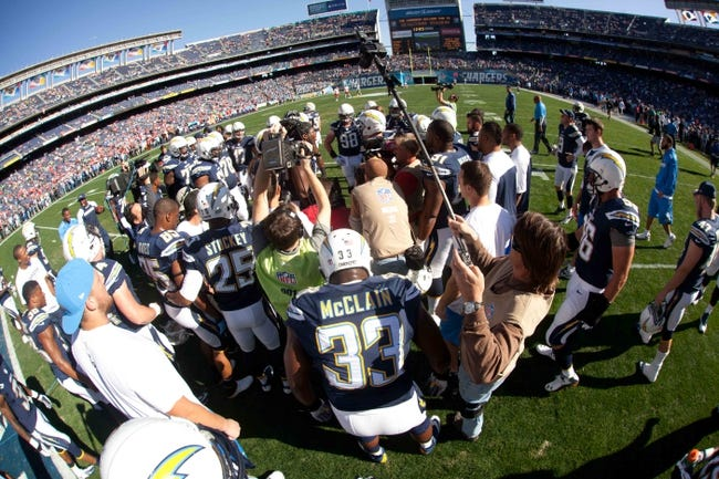 Dec 29, 2013; San Diego, CA, USA;  The San Diego Chargers huddle at the start of the Chargers 27-24 overtime win against the Kansas City Chiefs at Qualcomm Stadium. Mandatory Credit: Stan Liu-USA TODAY Sports