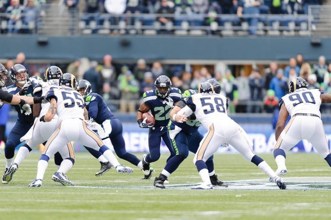 Dec 29, 2013; Seattle, WA, USA; Seattle Seahawks running back Robert Turbin (22) carries the ball against the St. Louis Rams during the game at CenturyLink Field. Seattle defeated St. Louis 27-9. Mandatory Credit: Steven Bisig-USA TODAY Sports