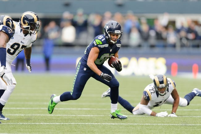 Dec 29, 2013; Seattle, WA, USA; Seattle Seahawks wide receiver Golden Tate (81) carries the ball against the St. Louis Rams during the game at CenturyLink Field. Seattle defeated St. Louis 27-9. Mandatory Credit: Steven Bisig-USA TODAY Sports
