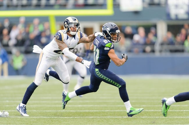 Dec 29, 2013; Seattle, WA, USA; Seattle Seahawks wide receiver Golden Tate (81) breaks a tackle by St. Louis Rams cornerback Trumaine Johnson (22) during the game at CenturyLink Field. Seattle defeated St. Louis 27-9. Mandatory Credit: Steven Bisig-USA TODAY Sports