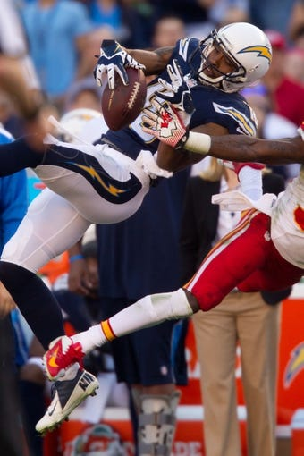Dec 29, 2013; San Diego, CA, USA;  San Diego Chargers wide receiver Eddie Royal (11) bobbles the ball during the Chargers 27-24 overtime win against the Kansas City Chiefs at Qualcomm Stadium. Mandatory Credit: Stan Liu-USA TODAY Sports