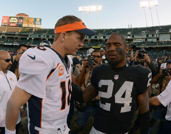 Dec 29, 2013; Oakland, CA, USA; Denver Broncos quarterback Peyton Manning (18) shakes hands with Oakland Raiders safety Charles Woodson (24) after the game at O.co Coliseum. The Broncos defeated the Raiders 34-14. Mandatory Credit: Kirby Lee-USA TODAY Sports