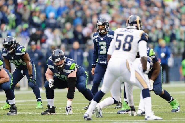 Dec 29, 2013; Seattle, WA, USA; Seattle Seahawks quarterback Russell Wilson (3) during the game against the St. Louis Rams at CenturyLink Field. Seattle defeated St. Louis 27-9. Mandatory Credit: Steven Bisig-USA TODAY Sports