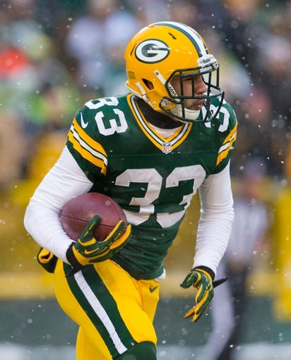Dec 22, 2013; Green Bay, WI, USA; Green Bay Packers cornerback Micah Hyde (33) during the game against the Pittsburgh Steelers at Lambeau Field.  Pittsburgh won 38-31.  Mandatory Credit: Jeff Hanisch-USA TODAY Sports