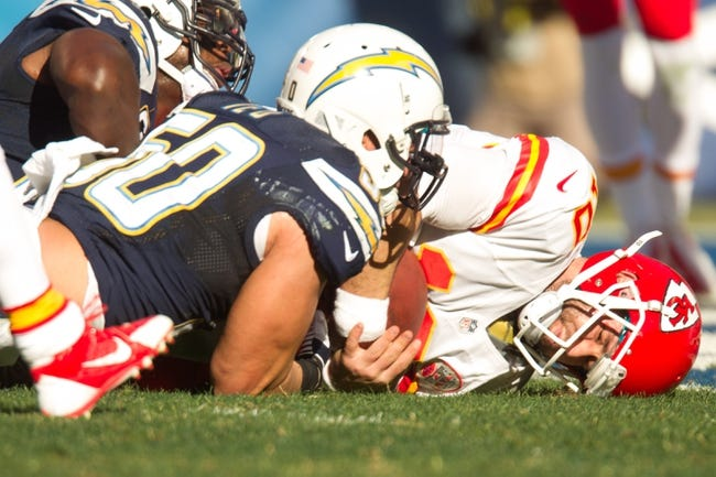 Dec 29, 2013; San Diego, CA, USA;  Kansas City Chiefs quarterback Chase Daniel (10) is tackled by San Diego Chargers linebacker Manti Te'o (50) during the Chiefs 27-24 overtime loss to the Chargers at Qualcomm Stadium. Mandatory Credit: Stan Liu-USA TODAY Sports