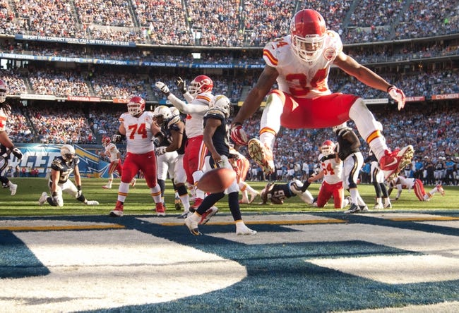 Dec 29, 2013; San Diego, CA, USA;  Kansas City Chiefs running back Knile Davis (34) celebrates a touchdown during the Chiefs 27-24 overtime loss to the San Diego Chargers at Qualcomm Stadium. Mandatory Credit: Stan Liu-USA TODAY Sports