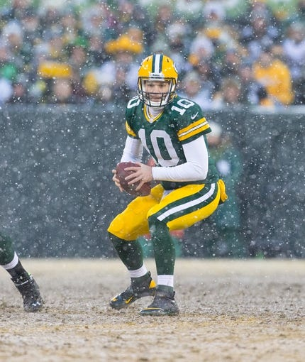 Dec 22, 2013; Green Bay, WI, USA; Green Bay Packers quarterback Matt Flynn (10) during the game against the Pittsburgh Steelers at Lambeau Field.  Pittsburgh won 38-31.  Mandatory Credit: Jeff Hanisch-USA TODAY Sports