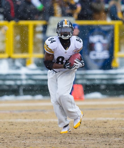 Dec 22, 2013; Green Bay, WI, USA; Pittsburgh Steelers wide receiver Antonio Brown (84) during warmups prior to the game against the Green Bay Packers at Lambeau Field.  Pittsburgh won 38-31.  Mandatory Credit: Jeff Hanisch-USA TODAY Sports