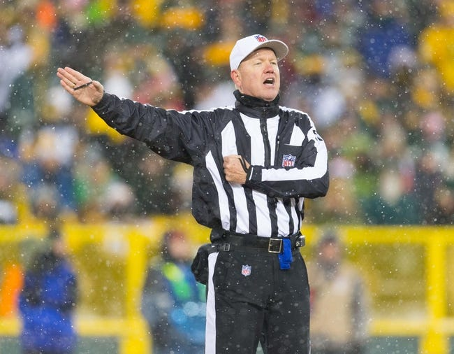 Dec 22, 2013; Green Bay, WI, USA; NFL referee Carl Cheffers (51) signals during the game between the Pittsburgh Steelers and Green Bay Packers at Lambeau Field.  Pittsburgh won 38-31.  Mandatory Credit: Jeff Hanisch-USA TODAY Sports