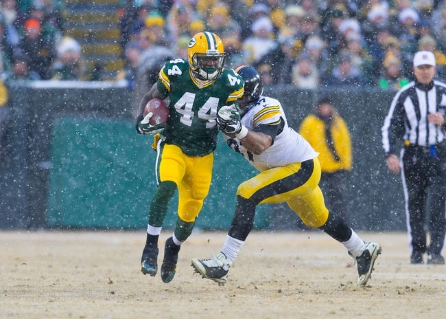 Dec 22, 2013; Green Bay, WI, USA; Green Bay Packers running back James Starks (44) during the game against the Pittsburgh Steelers at Lambeau Field.  Pittsburgh won 38-31.  Mandatory Credit: Jeff Hanisch-USA TODAY Sports