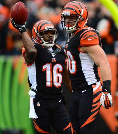 Dec 29, 2013; Cincinnati, OH, USA; Cincinnati Bengals wide receiver Andrew Hawkins (16) against the Baltimore Ravens at Paul Brown Stadium. Bengals defeated the Ravens 34-17. Mandatory Credit: Andrew Weber-USA TODAY Sports