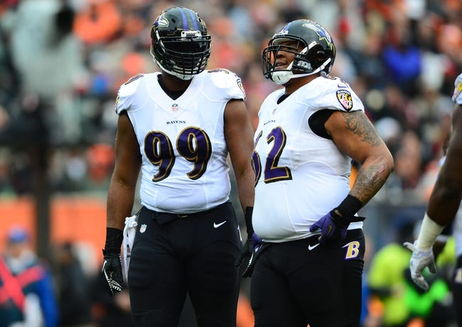 Dec 29, 2013; Cincinnati, OH, USA; Baltimore Ravens defensive end Chris Canty (99) and nose tackle Terrence Cody (62) against the Cincinnati Bengals at Paul Brown Stadium. Bengals defeated the Ravens 34-17. Mandatory Credit: Andrew Weber-USA TODAY Sports