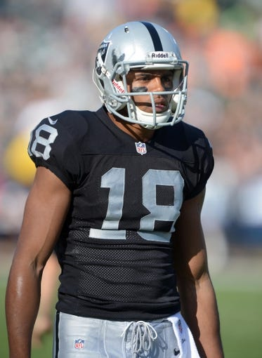 Dec 29, 2013; Oakland, CA, USA; Oakland Raiders receiver Andre Holmes (18) during the game against the Denver Broncos at O.co Coliseum. The Broncos defeated the Raiders 34-14. Mandatory Credit: Kirby Lee-USA TODAY Sports