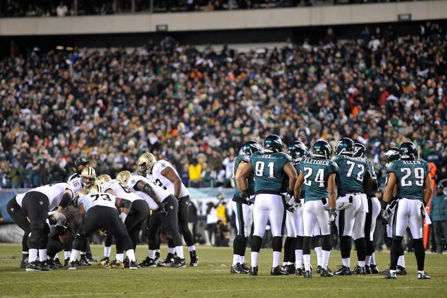Jan 4, 2014; Philadelphia, PA, USA; Philadelphia Eagles defensive players and New Orleans Saints offensive players huddle during the 2013 NFC wild card playoff football game at Lincoln Financial Field. The New Orleans Saints won the game 26-24. Mandatory Credit: Joe Camporeale-USA TODAY Sports
