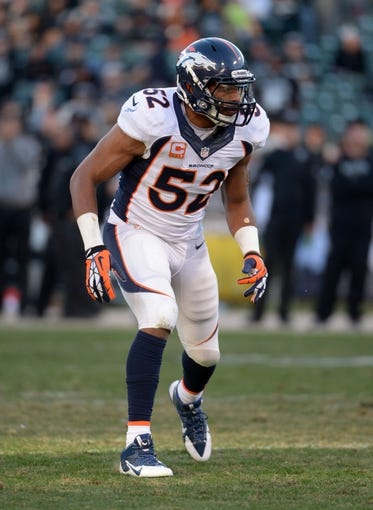 Dec 29, 2013; Oakland, CA, USA; Denver Broncos linebacker Wesley Woodyard (52) during the game against the Oakland Raiders at O.co Coliseum. The Broncos defeated the Raiders 34-14. Mandatory Credit: Kirby Lee-USA TODAY Sports
