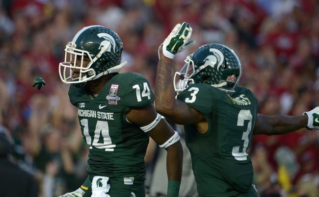 Jan 1, 2014; Pasadena, CA, USA; Michigan State Spartans receiver Tony Lippett (14) celebrates with receiver Macgarrett Kings Jr. (3) after scoring on a 25-yard touchdown reception in the third quarter against the Stanford Cardinal in the 100th Rose Bowl. Michigan State defeated Stanford 24-20. Mandatory Credit: Kirby Lee-USA TODAY Sports