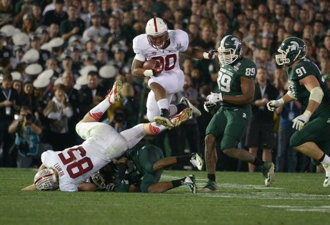 Jan 1, 2014; Pasadena, CA, USA; Stanford Cardinal running back Ricky Seale (30) carries the ball against the Michigan State Spartans in the 100th Rose Bowl. Michigan State defeated Stanford 24-20. Mandatory Credit: Kirby Lee-USA TODAY Sports